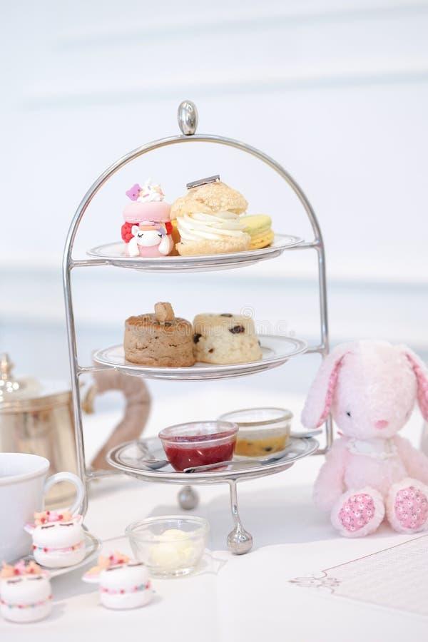 Afternoon tea set. A tea time with cute unicorn macarons stock image