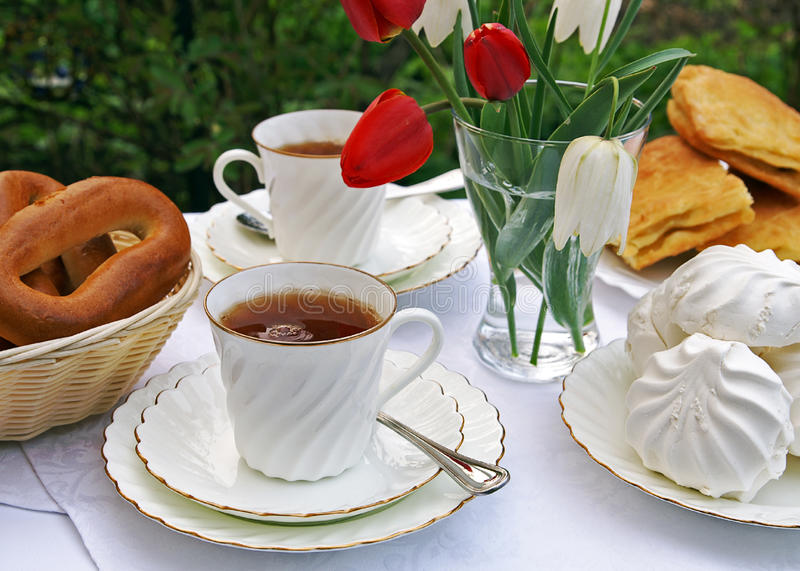 Afternoon tea in a summer garden stock photo
