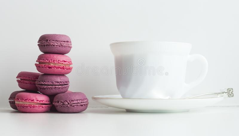 Afternoon tea table with colorful macarons and a tea cup royalty free stock photos