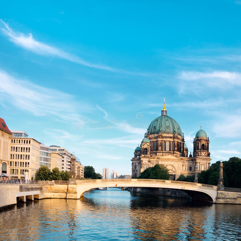 Afternoon view on Berlin Cathedral over Spree river. Panorama image with beautiful clouds. This image is toned royalty free stock image