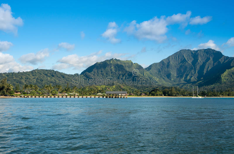 Afternoon view of Hanalei Bay and Pier on Kauai Hawaii. Afternoon from boat trip at Hanalei Bay and pier with the Na Pali coast in the background near Hanalei royalty free stock photo