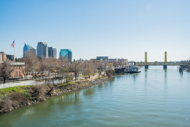 Afternoon view of Sacramento skyline with Sacramento River. Sacramento, FEB 21: Afternoon view of Sacramento skyline with Sacramento River on FEB 21, 2018 at stock photo