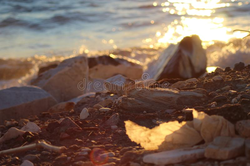 The afternoon walk at the beach with the view f the sunset. This photo is made in Marina di Massa, Italy during the sunset. you can see the beautiful colors royalty free stock image