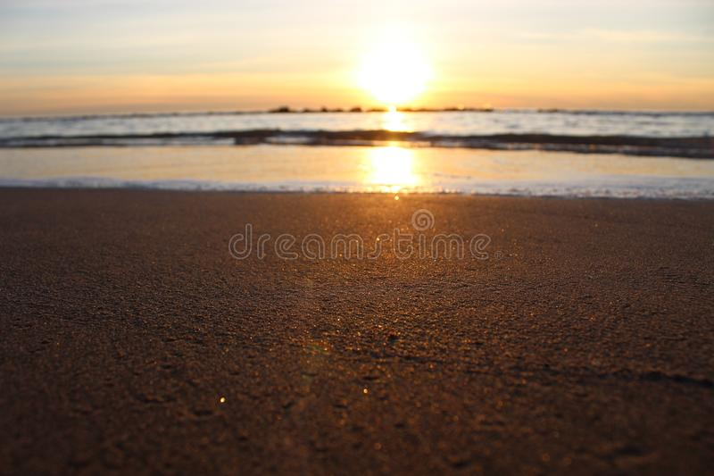 The afternoon walk at the beach with the view f the sunset. This photo is made in Marina di Massa, Italy during the sunset. you can see the beautiful colors royalty free stock photos