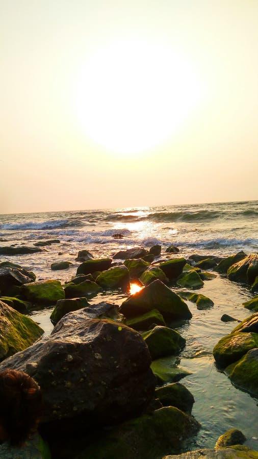 Aftonsolnedgång på stranden arkivfoton