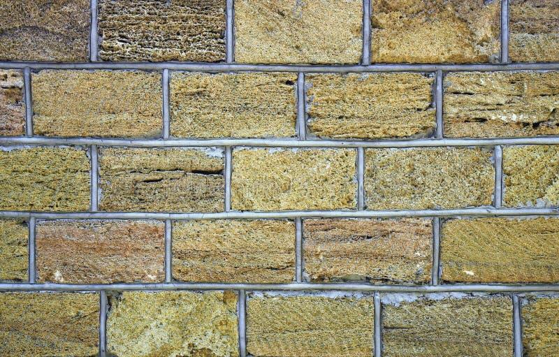 Afzettingsgesteentemuur, omheining, buitenkant, textuur Wijd gebruikt in kustplaatsen voor bouwstijlmuur van huis of omheining, d stock foto's