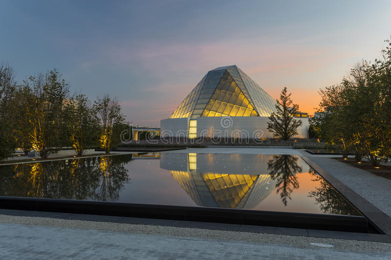 Aga Khan Museum Garden. Aga Khan Museum in Toronto, Ontario at twilight with pond reflections stock image