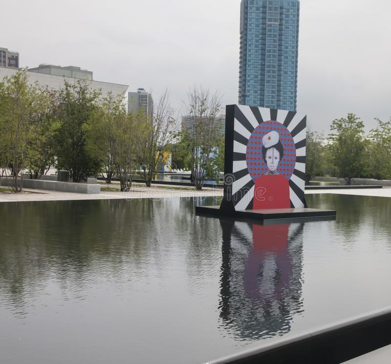 Aga Khan Museum In Toronto. The reflecting pools in the Aga Khan Museum transformed into an exhibition venue.n It presents large-scale portraits of women by royalty free stock images