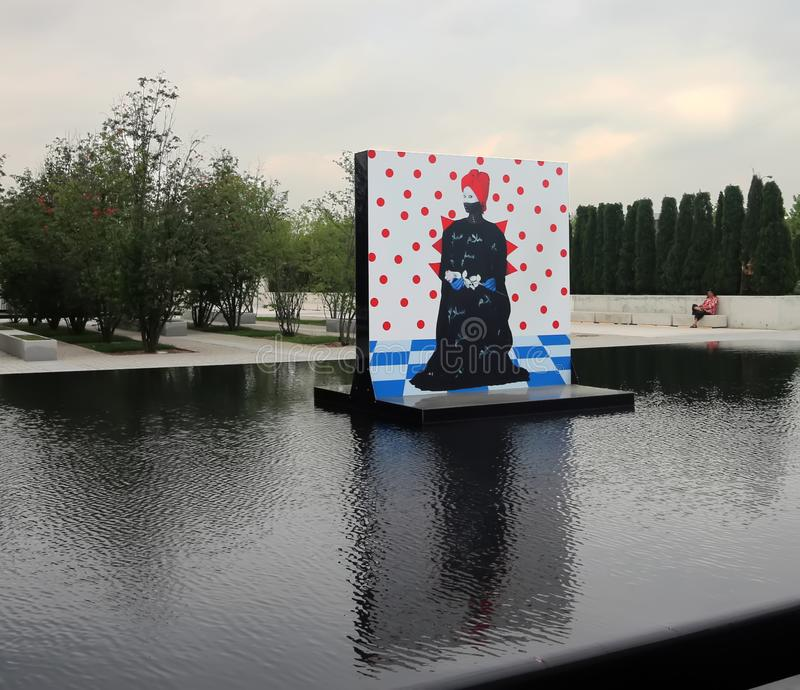 Aga Khan Museum In Toronto. The reflecting pools in the Aga Khan Museum transformed into an exhibition venue. It presents large-scale portraits of women by royalty free stock photography