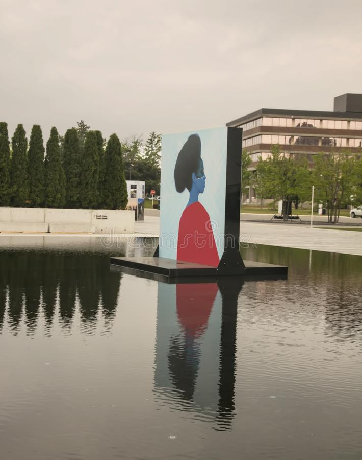 Aga Khan Museum In Toronto. The reflecting pools in the Aga Khan Museum transformed into an exhibition venue. It presents large-scale portraits of women by stock photography