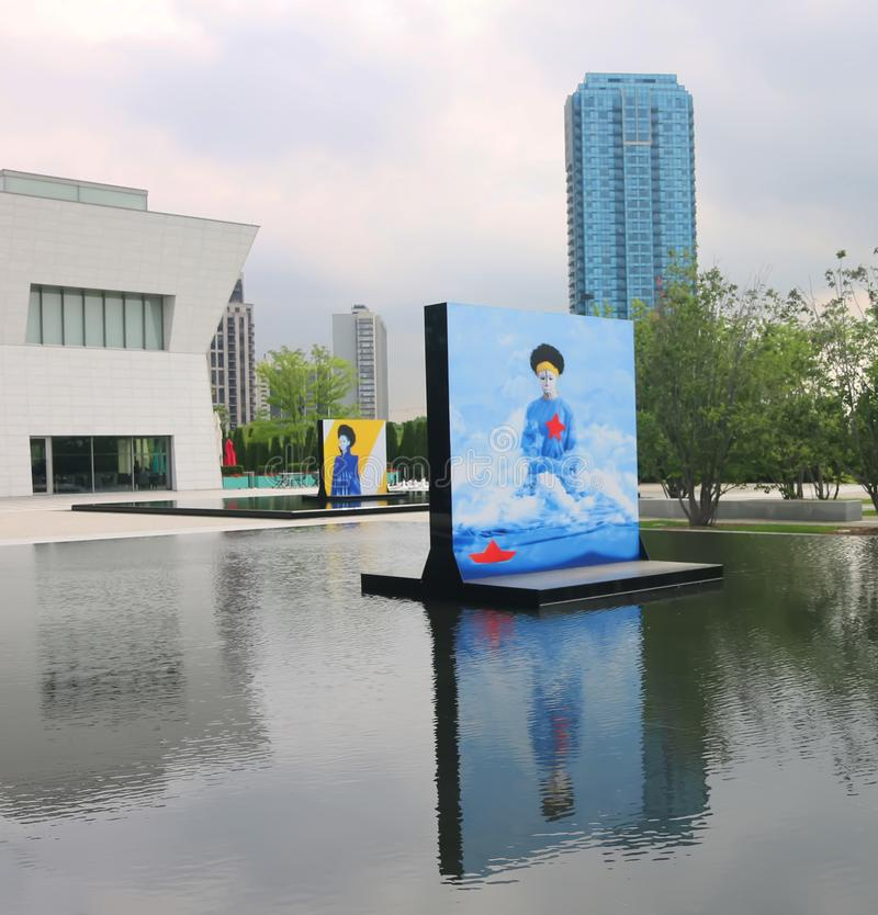 Aga Khan Museum In Toronto. The reflecting pools in the Aga Khan Museum transformed into an exhibition venue. It presents large-scale portraits of women by stock photo