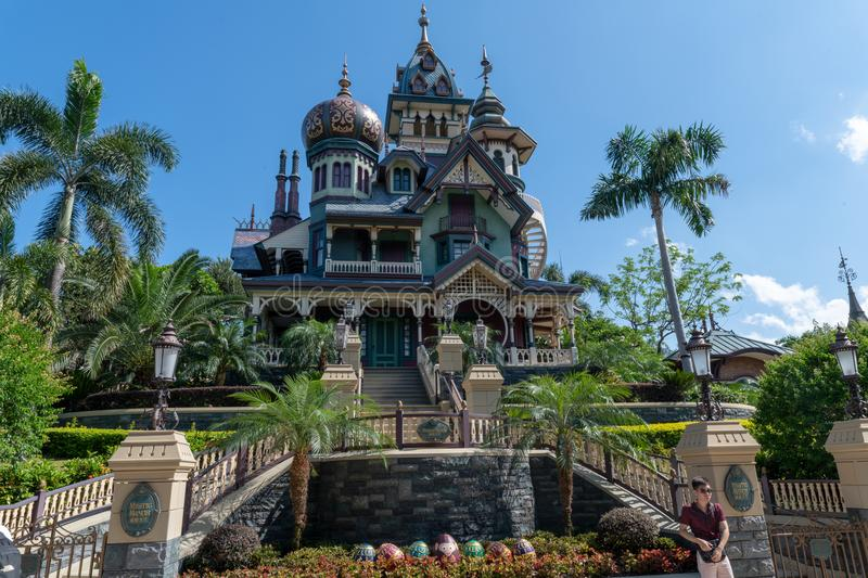 Haunted house in disneyland hong kong amusement park, big bold, daytime stock images