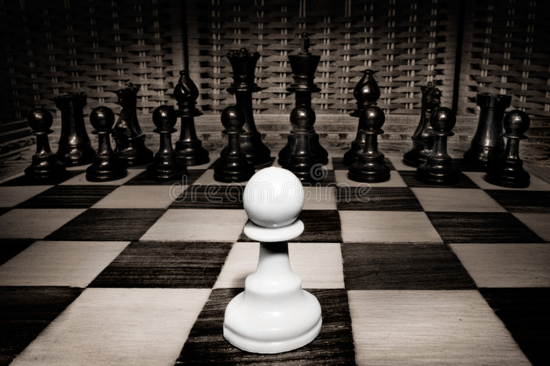 Against the odds. A white pawn is pitted against the entire black army, good concept shot