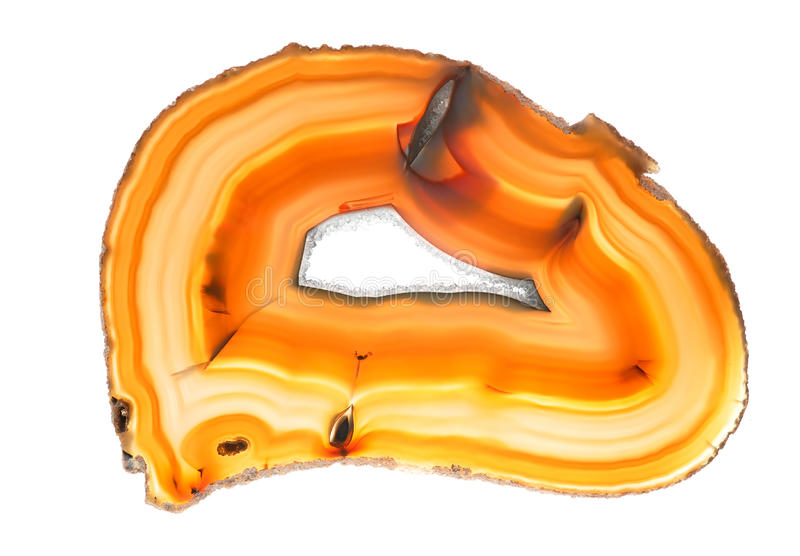 Agate. A polished, translucent slice of banded agate stock photos