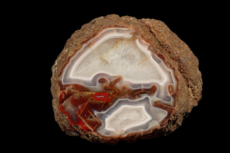 Agate. A cross section of agate stone on a black background. Origin: Morocco, Kerriuchen royalty free stock images