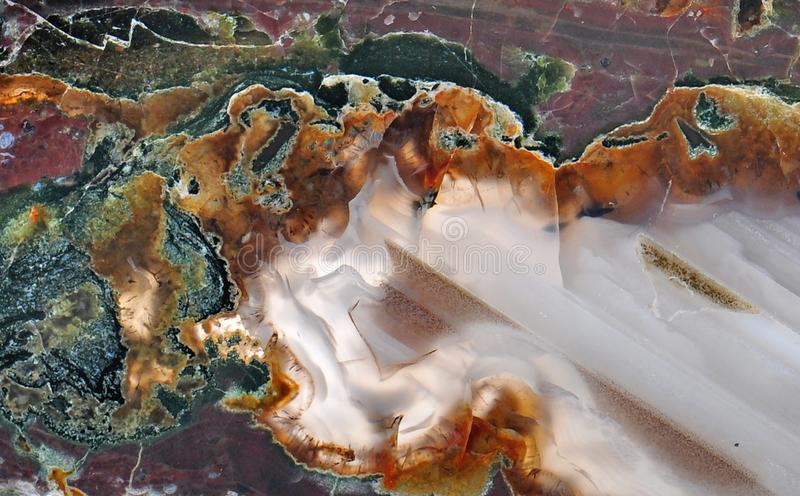 Agate with natural colors. Polished cut stock photography