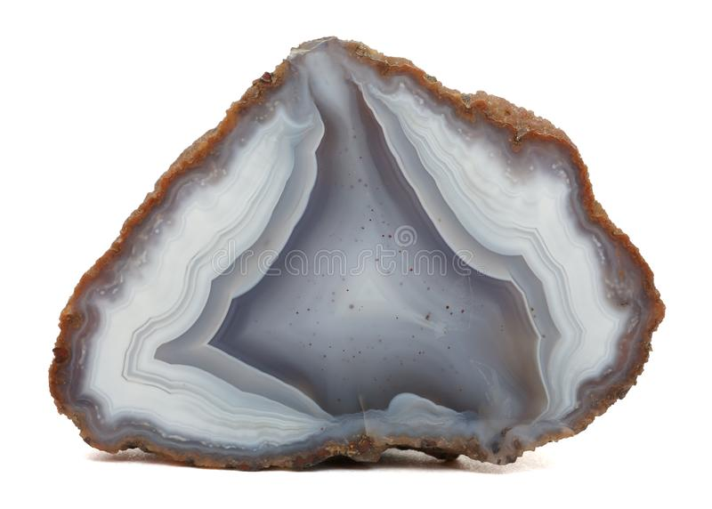 Agate specimen. Polished agate specimen in black and gray colors, isolated on a white background royalty free stock photography