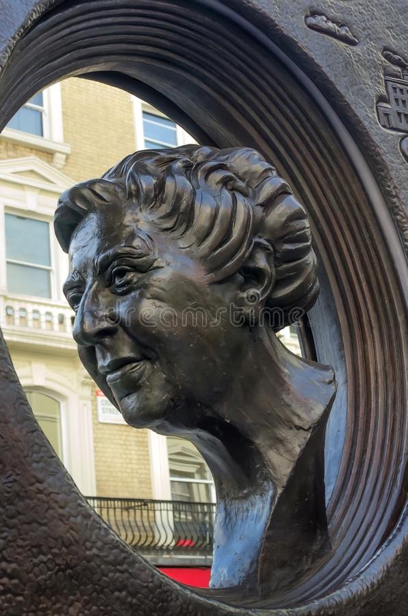 Agatha Christie book shaped memorial. LONDON, UK - FEB 18 2018: Agatha Christie book shaped memorial at Cranbourn Street, Covent Garden, The bronze memorial `The royalty free stock photography