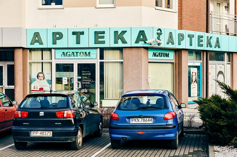 Agatom pharmacy shop. Parked cars in front of a Agatom pharmacy shop on the Malta district on circa January 2018 in Poznan, Poland royalty free stock photo