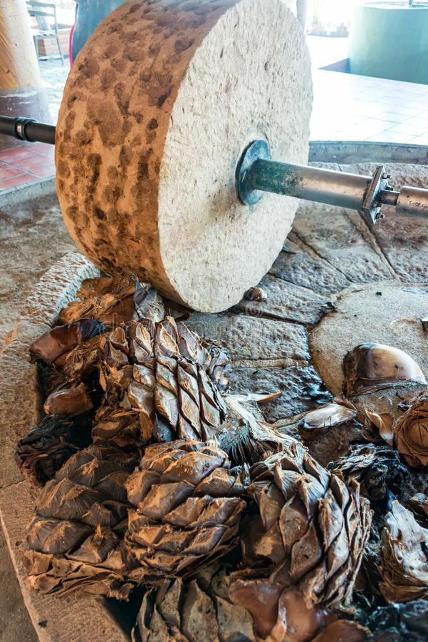 Agave Grinding Wheel. Horse powered stone grinding wheel used in the production of mezcal in Oaxaca, Mexico royalty free stock photos