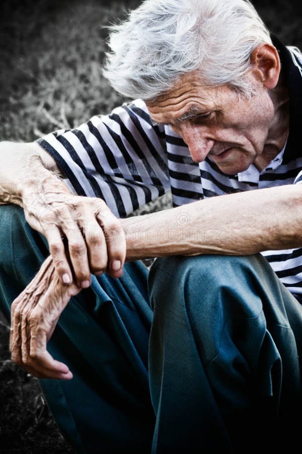 Age and depression concept - sad senior old man stock photo