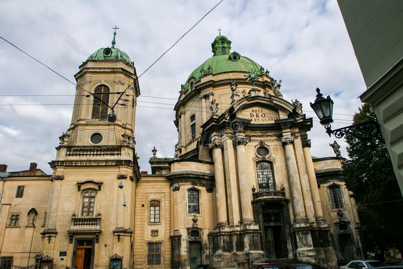 Age-old Dominic Oder Cathedral with two Domes. Against blue sky and white clouds in old european city stock photo