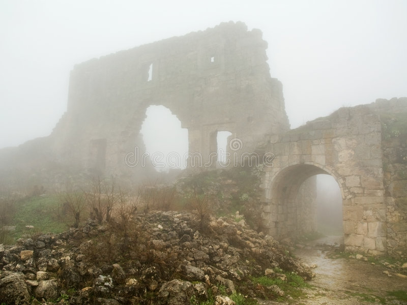 Age-old stronghold gate arched mist morning stock image