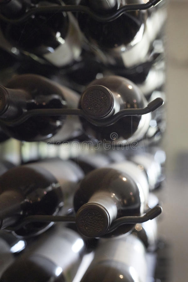 Aged bottles of wine. Very aged bottles of wine covered in dust royalty free stock images