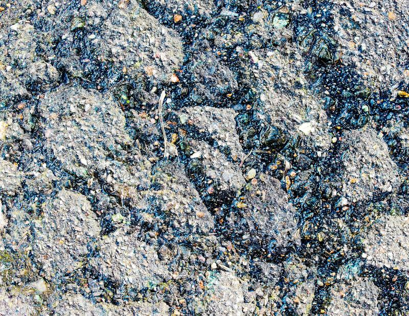 Aged and broken asphalt textures of old european roads and streets royalty free stock photography
