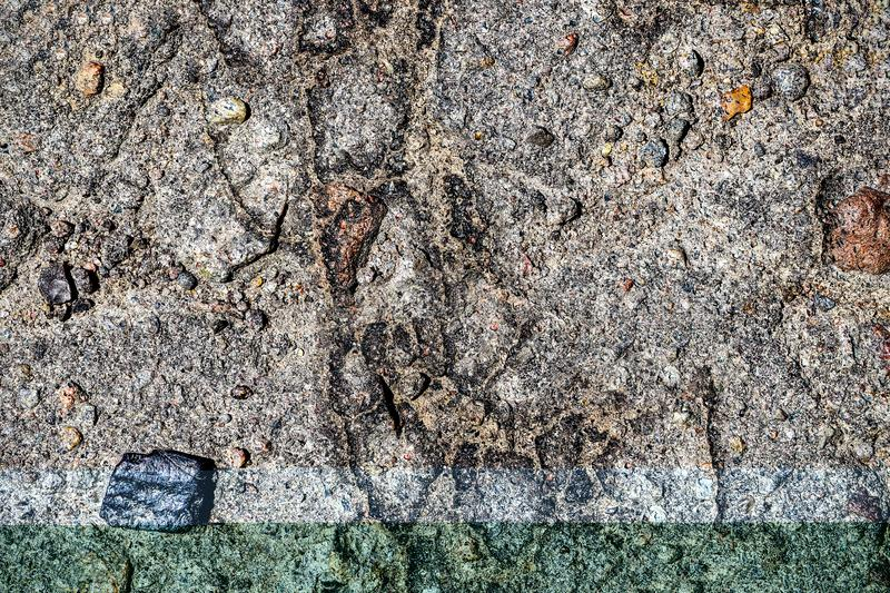 Aged and broken asphalt textures of old european roads and streets royalty free stock photo