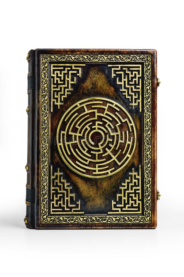 Aged brown leather book cover with labyrinth on the front cover. Captured frontal while stay up to the table royalty free stock photography