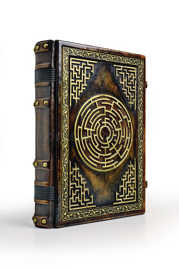Aged brown leather book cover with labyrinth on the front cover. Captured while stay up to the table stock photos