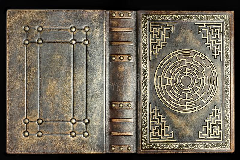 Aged brown leather book cover with labyrinth on the front cover. Captured opened and royalty free stock photos