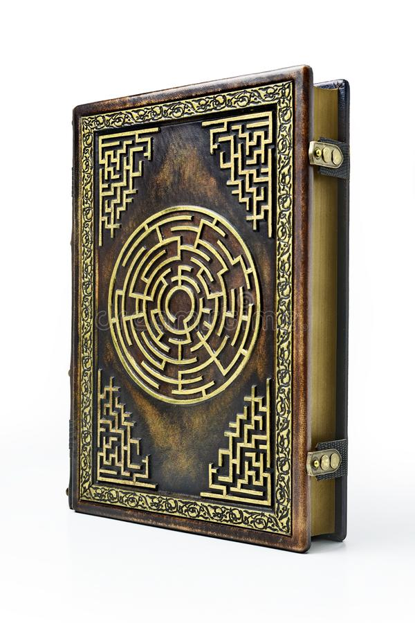 Aged brown leather book cover with labyrinth on the front cover. royalty free stock photo