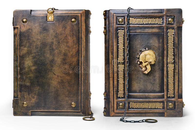 Aged brown leather book with the Latin text Memento Mori Remember you must die as a gilded frame, the skull in the center. And the chain over the cover captured stock images