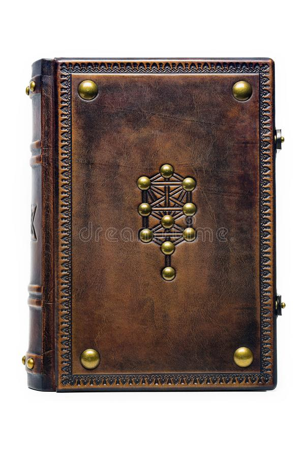 Aged brown leather bound book with embossed the Tree of Life symbol. On the front cover royalty free stock photos