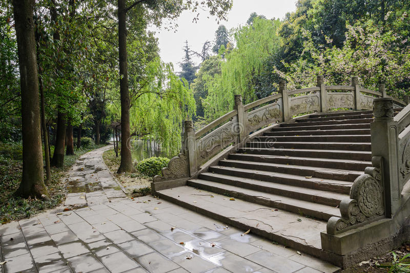 Aged Chinese arch bridge in verdant spring royalty free stock image