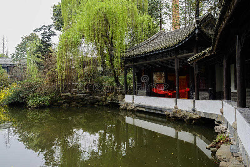Aged Chinese gallery by water in spring royalty free stock photo