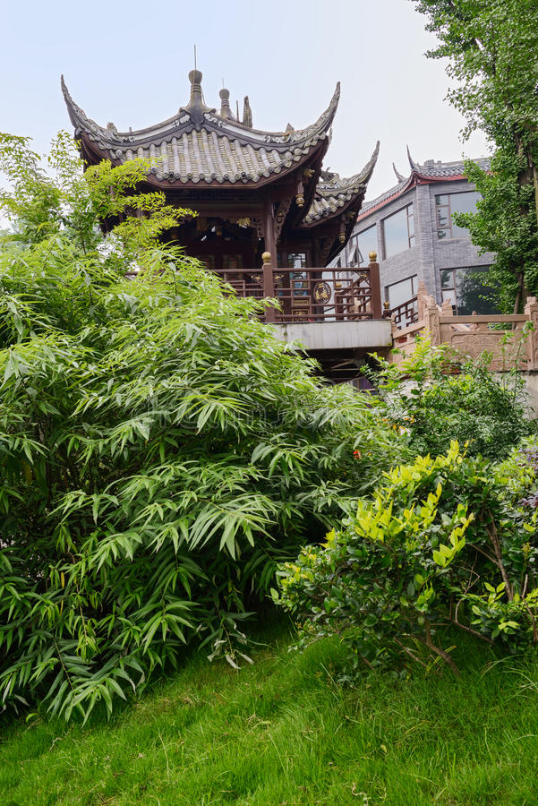Aged Chinese pavilion in verdant green royalty free stock photography