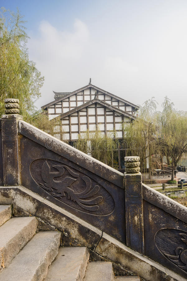 Aged Chinese stone stairway in small town at sunny winter noon stock images