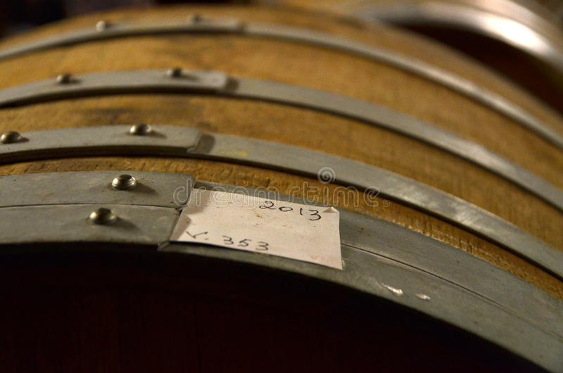 Aged cognac barrels. Aged cognac barrel from 2013 in a private distillery in France stock photography