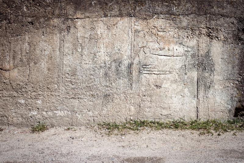 Aged concrete wall. Aged weathered cracked concrete wall background stock photography
