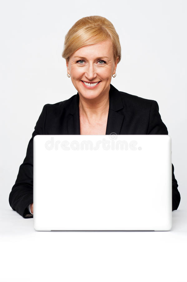 Download Aged Corporate Lady Working On A Laptop Stock Image - Image: 25997361