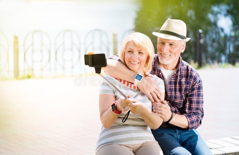 Aged couple enjoying each other stock images