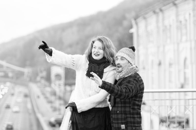 Aged couple happy standing on bridge. Woman and man pointing out. Aged couple happy standing on bridge. Woman and men point to other side. Couple of tourists royalty free stock images