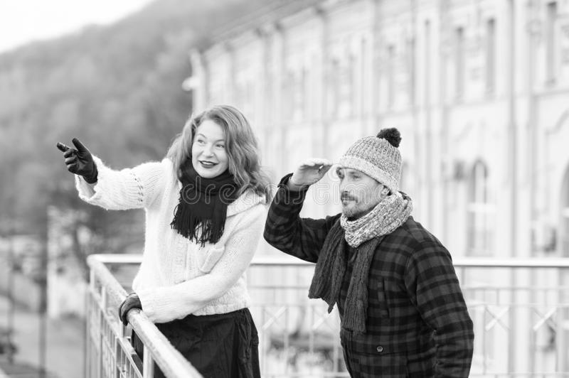 Aged couple looking for friends on other side of bridge. Guy looking in far. Smiled woman pointing by hand. Aged couple looking for friends on other side of royalty free stock photo