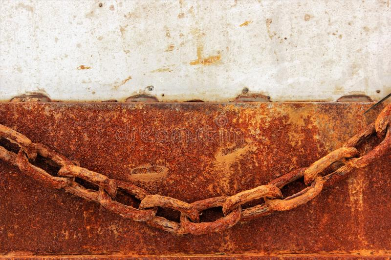 Rusty chain close up. Aged, decaying rusty chain - concept of togetherness, toghness, teanwork, stability, strenght stock photo