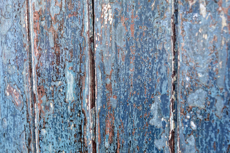 Aged/distressed blue painted wood panels stock image
