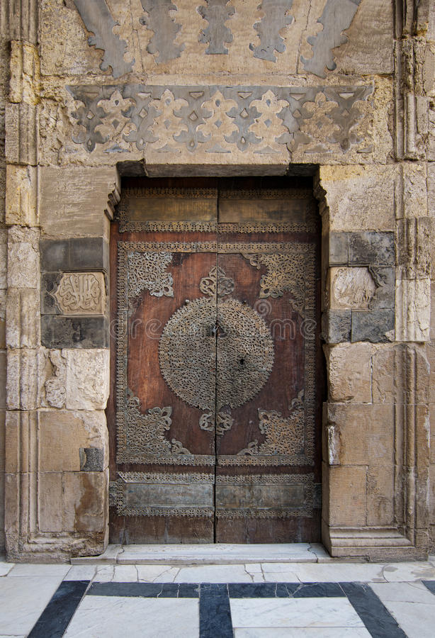 An aged door at the courtyard of an old mosque stock photos
