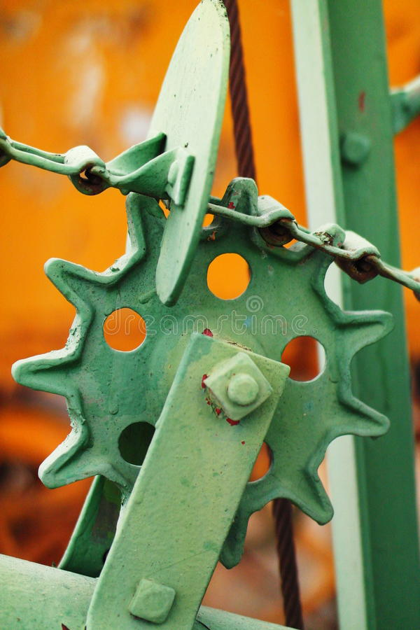 Aged farm equipment. Old farm equipment resting in a field stock image